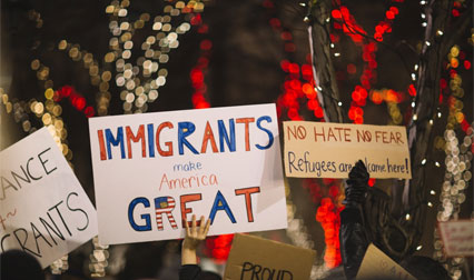immigrants rally - Why immigration and terrorism shouldn't be linked to each other